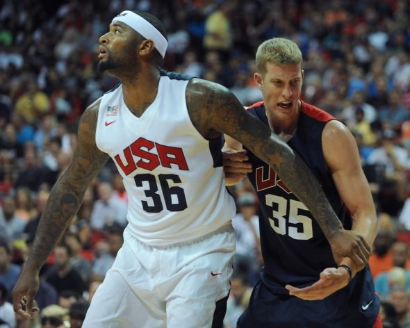 Aug 1, 2014; Las Vegas, NV, USA; USA Team Blue forward Mason Plumlee (35) reacts to his wrist being held by USA Team White center DeMarcus Cousins (36) during the USA Basketball Showcase at Thomas & Mack Center. Mandatory Credit: Stephen R. Sylvanie-USA TODAY Sports
