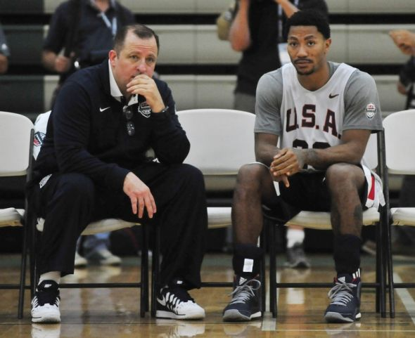 Aug 15, 2014; Chicago, IL, USA; USA guard Derrick Rose (right) talks with assistant coach Tom Thibodeau during practice at Quest MultiSport Complex. Mandatory Credit: David Banks-USA TODAY Sports