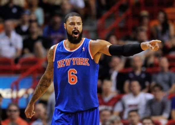 Apr 6, 2014; Miami, FL, USA; New York Knicks center Tyson Chandler (6) reacts during the first half against the Miami Heat at American Airlines Arena. Mandatory Credit: Steve Mitchell-USA TODAY Sports
