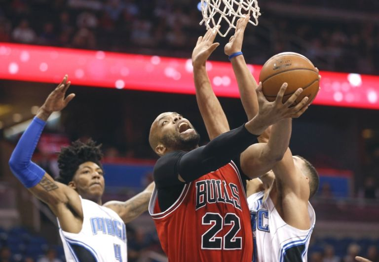 9212672-aaron-gordon-elfrid-payton-taj-gibson-nba-chicago-bulls-orlando-magic-768x531