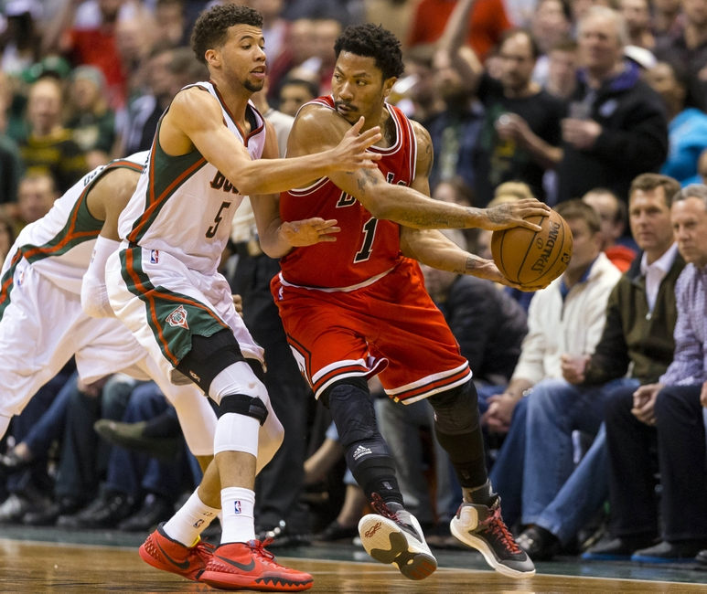 8535336-derrick-rose-michael-carter-williams-nba-playoffs-chicago-bulls-milwaukee-bucks