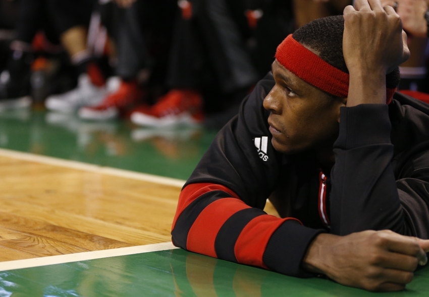 Nov 2, 2016; Boston, MA, USA; Chicago Bulls point guard Rajon Rondo (9) watches the game from the side line while laying on the floor during the fourth quarter against the Boston Celtics at TD Garden. The Boston Celtics won 107-100. Mandatory Credit: Greg M. Cooper-USA TODAY Sports