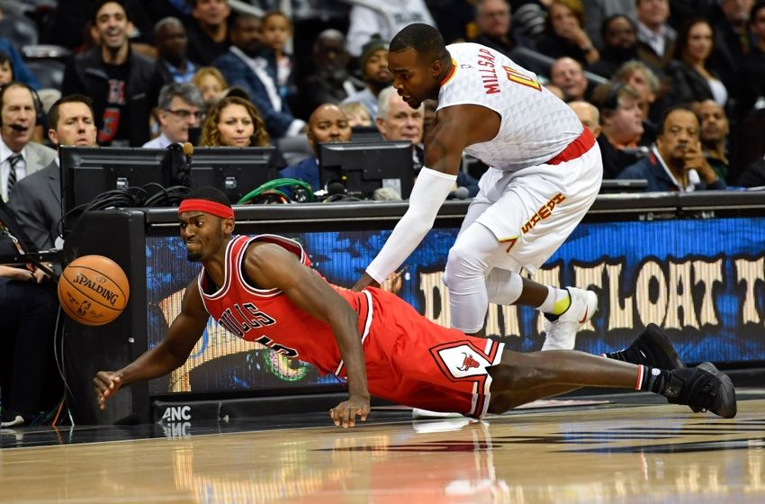 Nov 9, 2016; Atlanta, GA, USA; Chicago Bulls forward Bobby Portis (5) dives for a loose ball on the floor in front of Atlanta Hawks forward Paul Millsap (4) during the first half at Philips Arena. Mandatory Credit: Dale Zanine-USA TODAY Sports