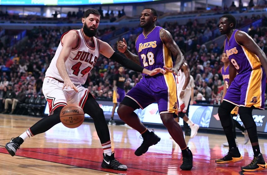 Nov 30, 2016; Chicago, IL, USA; Chicago Bulls forward Nikola Mirotic (44) dribbles the ball against Los Angeles Lakers center Tarik Black (28) during the first half at the United Center. Mandatory Credit: Mike DiNovo-USA TODAY Sports