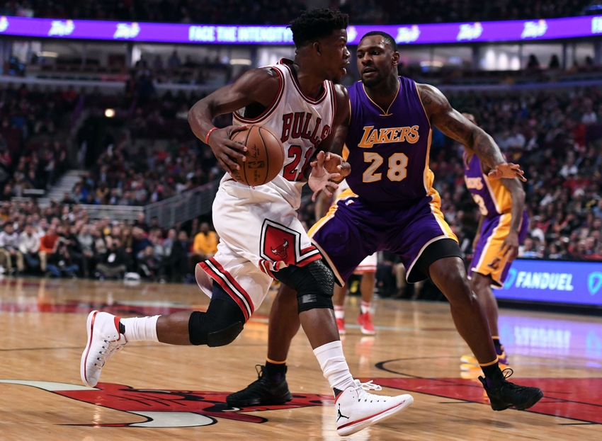 Nov 30, 2016; Chicago, IL, USA; Chicago Bulls forward Jimmy Butler (21) dribbles the ball against Los Angeles Lakers center Tarik Black (28) during the first half at the United Center. Mandatory Credit: Mike DiNovo-USA TODAY Sports