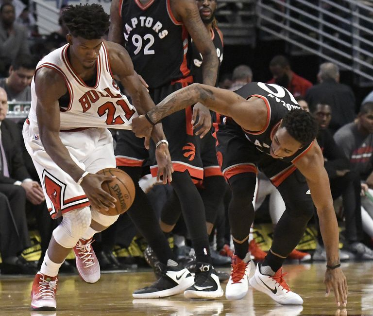 Jan 7, 2017; Chicago, IL, USA;  Chicago Bulls forward Jimmy Butler (21) and Toronto Raptors guard DeMar DeRozan (10) go for the ball during the second half at the United Center. The Bulls won 123-118 in overtime. Mandatory Credit: David Banks-USA TODAY Sports