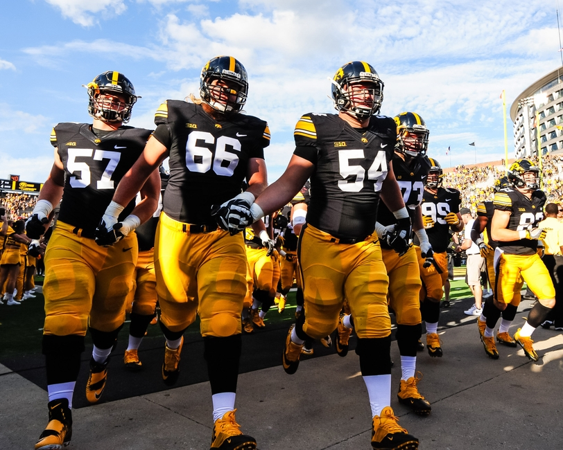 Sep 3, 2016; Iowa City, IA, USA; Iowa Hawkeyes offensive lineman Steve Ferentz (54) and offensive lineman Levi Paulsen (66) offensive lineman Jake Newborg (57) hold hands with teammates as they come off the field after the game against the Miami (Oh) Redhawks at Kinnick Stadium. The Hawkeyes won 45-21. Mandatory Credit: Jeffrey Becker-USA TODAY Sports
