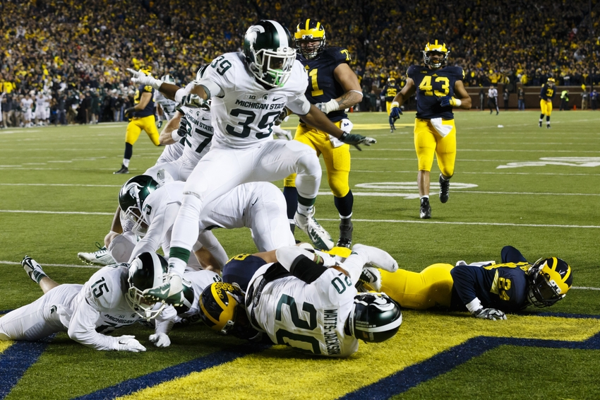 8878237-ncaa-football-michigan-state-michigan