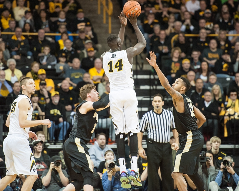 Jan 24, 2016; Iowa City, IA, USA; Iowa Hawkeyes guard Peter Jok (14) shoots the ball as Purdue Boilermakers forward Vince Edwards (12) defends during the second half at Carver-Hawkeye Arena. Iowa won 83-71. Mandatory Credit: Jeffrey Becker-USA TODAY Sports