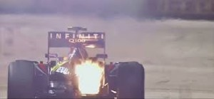 Mark Webber's Red Bull's engine engulfed in flame.