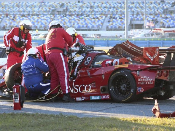 The injured Memo Gidley is extracted from his racecar by safety workers. Credit: AP/Dow Graham
