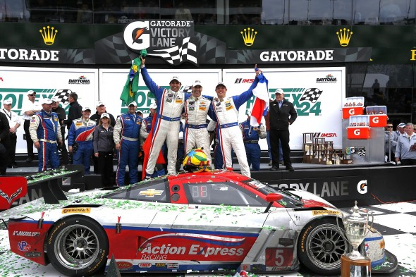 The victorious Action Express Racing team in victory lane. Credit: Michael L. Levitt, LAT Photo USA.