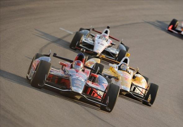 Jun 8, 2013; Fort Worth, TX, USA; IndyCar Series driver Marco Andretti (25) and Ryan Hunter-Reay (1) and Will Power (12) drives through turn two during the Firestone 550 at Texas Motor Speedway. Mandatory Credit: Jerome Miron-USA TODAY Sports