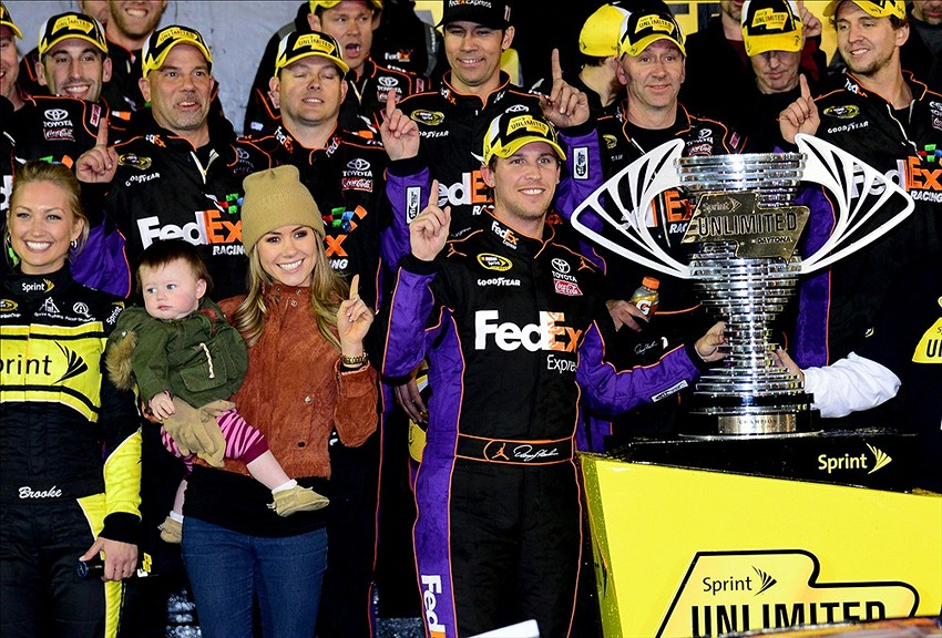 Feb 15, 2014; Daytona Beach, FL, USA; NASCAR Sprint Cup Series driver Denny Hamlin celebrates winning the Sprint Unlimited at Daytona International Speedway. Mandatory Credit: Jasen Vinlove-USA TODAY Sports