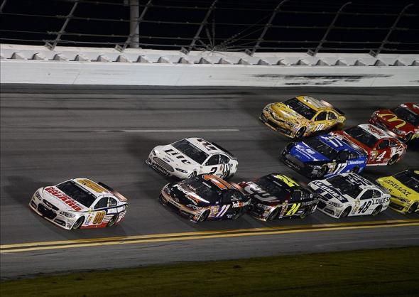 Feb 23, 2014; Daytona Beach, FL, USA; NASCAR Sprint Cup Series driver Dale Earnhardt, Jr. (88), Denny Hamlin (11) and Brad Keselowski (2) during the Daytona 500 at Daytona International Speedway. Mandatory Credit: Mike DiNovo-USA TODAY Sports