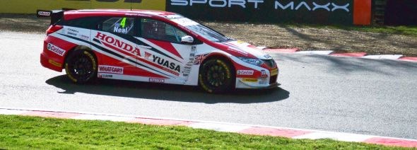 Matt Neal takes Druids Hairpin in FP2 of the British Touring Car Championship. Credit: Adam Johnson