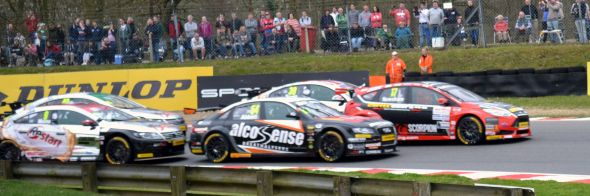 Dave Newsham, Aron Smith, Alain Menu, Hunter Abbot and Sam Tordoff battle at Druids Hairpin at Brands Hatch in Race 3 of the British Touring Car Championship. Credit: Adam Johnson