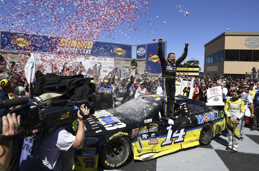 June 26, 2016; Sonoma, CA, USA; Sprint Cup Series driver Tony Stewart (14) celebrates in victory lane during the Toyota Save Mart 350 at Sonoma Raceway. Mandatory Credit: Kyle Terada-USA TODAY Sports