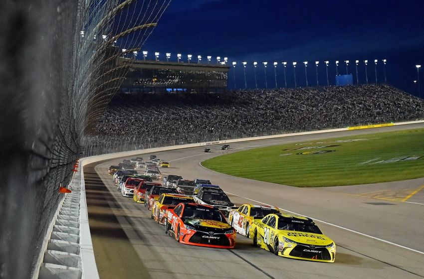 May 7, 2016; Kansas City, KS, USA; NASCAR Sprint Cup Series drivers Martin Truex Jr. (78) and Matt Kenseth (20) lead the field to restart the GoBowling.com 400 at Kansas Speedway. Mandatory Credit: Jasen Vinlove-USA TODAY Sports