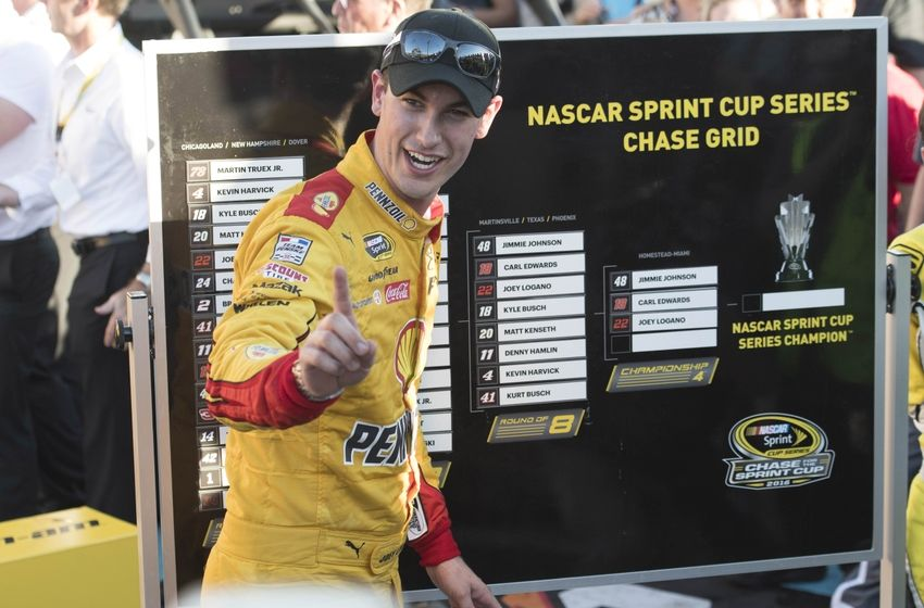 Nov 13, 2016; Avondale, AZ, USA; Sprint Cup Series driver Joey Logano (22) places his name on the chase grid after winning the Can-Am 500 at Phoenix International Raceway. Mandatory Credit: Jerome Miron-USA TODAY Sports