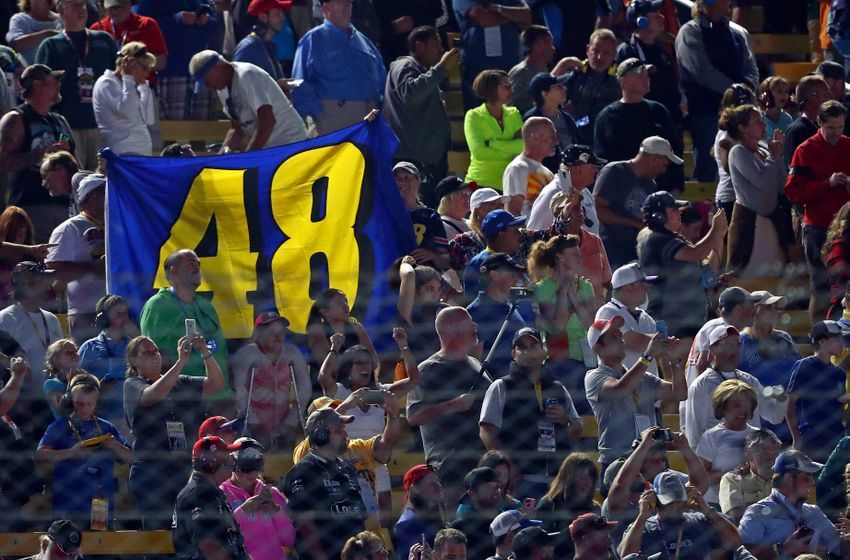 Nov 20, 2016; Homestead, FL, USA; Fans hold up a NASCAR Sprint Cup Series driver Jimmie Johnson (48) flag during the Ford Ecoboost 400 at Homestead-Miami Speedway. Mandatory Credit: Mark J. Rebilas-USA TODAY Sports