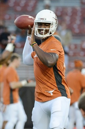Nov 28, 2013; Austin, TX, USA; Texas Longhorns quarterback Tyrone Swoopes (18) warms up prior to the game against the Texas Tech Red Raiders at Darrell K Royal-Texas Memorial Stadium. Mandatory Credit: Brendan Maloney-USA TODAY Sports