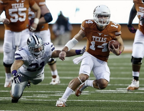 Sep 21, 2013; Austin, TX, USA; Texas Longhorns quarterback David Ash (14) runs and avoids the tackle by Kansas State Wildcats linebacker Jonathan Truman (21) during a football game at Darrell K Royal-Texas Memorial Stadium. Mandatory Credit: Jim Cowsert-USA TODAY Sports
