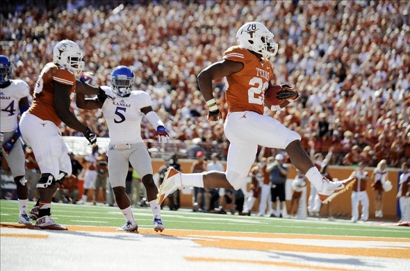 Nov 2, 2013; Austin, TX, USA; Texas Longhorns tailback Malcolm Brown (28) scores a touchdown against the Kansas Jayhawks during the second quarter at Darrell K Royal-Texas Memorial Stadium. Mandatory Credit: Brendan Maloney-USA TODAY Sports