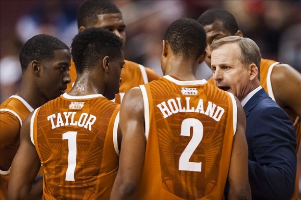 Dec 7, 2013; Philadelphia, PA, USA; Texas Longhorns head coach Rick Barnes talks with team during the first half against the Temple Owls at the Wells Fargo Center. Texas defeated Temple 81-80 in overtime. Mandatory Credit: Howard Smith-USA TODAY Sports