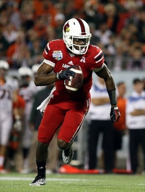 Dec 28, 2013; Orlando, FL, USA; Louisville Cardinals quarterback Teddy Bridgewater (5) rushes with the ball during the second half of the Russell Athletic Bowl against the Miami Hurricanes at Florida Citrus Bowl Stadium. Mandatory Credit: Rob Foldy-USA TODAY Sports