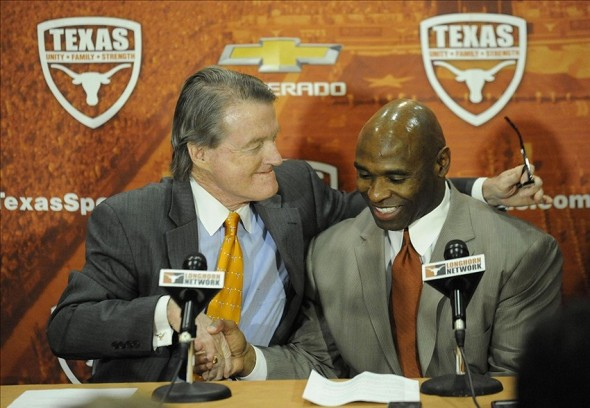 Jan 6, 2014; Austin, TX, USA; Texas Longhorns president Bill Powers (left) welcomes head football coach Charlie Strong (center) at a press conference in the Centennial Room of Belmont Hall at Texas-Memorial Stadium. Mandatory Credit: Brendan Maloney-USA TODAY Sports