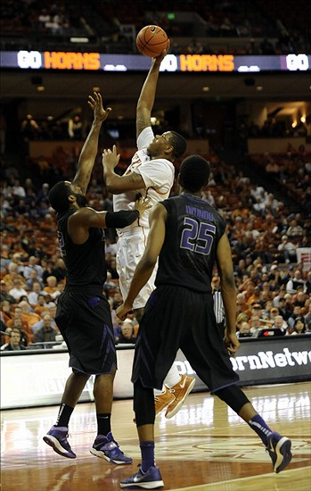 Jan 21, 2014; Austin, TX, USA; Texas Longhorns center Cameron Ridley (55) shoots against Kansas State Wildcats forwards Thomas Gipson (left) and Wesley Iwundu (25) during the second half at the Frank Erwin Special Events Center. Texas beat Kansas State 67-64. Mandatory Credit: Brendan Maloney-USA TODAY Sports
