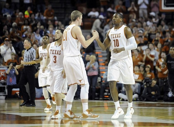 Jan 21, 2014; Austin, TX, USA; Texas Longhorns guard Javan Felix (3) and forwards Connor Lammert (21) and Jonathan Holmes (10) react against the Kansas State Wildcats during the second half at the Frank Erwin Special Events Center. Texas beat Kansas State 67-64. Mandatory Credit: Brendan Maloney-USA TODAY Sports