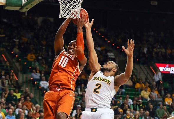 Jan 25, 2014; Waco, TX, USA; Texas Longhorns forward Jonathan Holmes (10) grabs a rebound in front of Baylor Bears forward Rico Gathers (2) during the first half at The Ferrell Center. Mandatory Credit: Kevin Jairaj-USA TODAY Sports