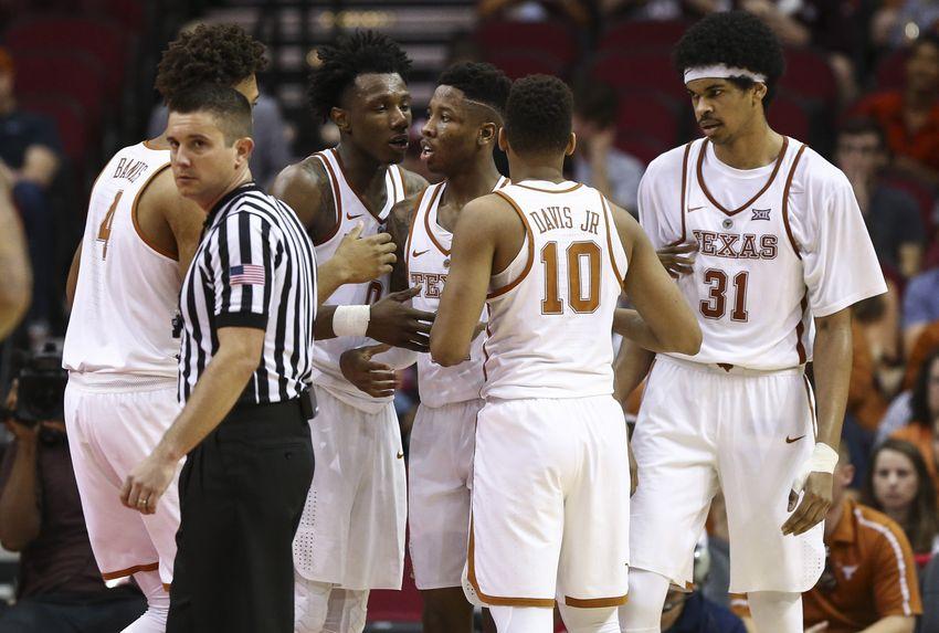 9751469-ncaa-basketball-arkansas-texas-1