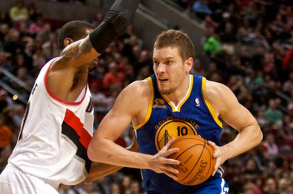 Mar 25, 2012; Portland, OR, USAGolden State Warriors power forward David Lee (10) drives past Portland Trail Blazers power forward LaMarcus Aldridge (left) at the Rose Garden. Mandatory Credit: Craig Mitchelldyer-US PRESSWIRE