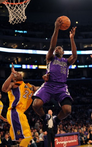Tyreke Evans drives past Kobed Bryant
