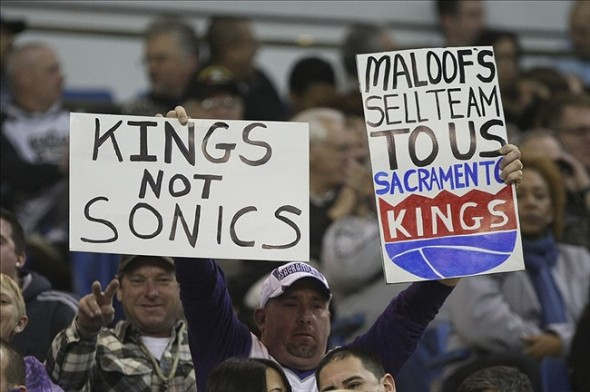 Jan 10, 2013; Sacramento, CA, USA; Sacramento Kings fans hold signs against the Maloof
