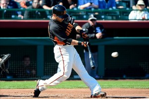 Scutaro hitting a single.