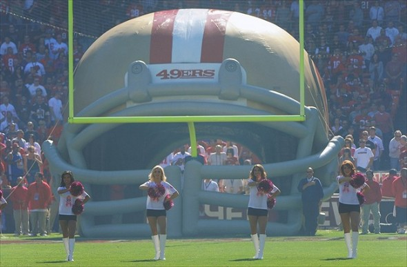 October 30, 2011; San Francisco, CA, USA; General view of San Francisco 49ers cheerleaders standing in front of a large 49ers helmet tunnel and goal post for the national anthem before the game between the San Francisco 49ers and the Cleveland Browns at Candlestick Park. Mandatory Credit: Kyle Terada-USA TODAY Sports