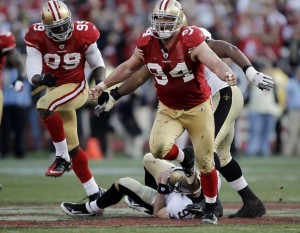 Justin Smith and Aldon Smith celebrate a sack of Drew Brees in the 49ers' 36-32 victory over the Saints last January. Photo: Michael Macor, The Chronicle