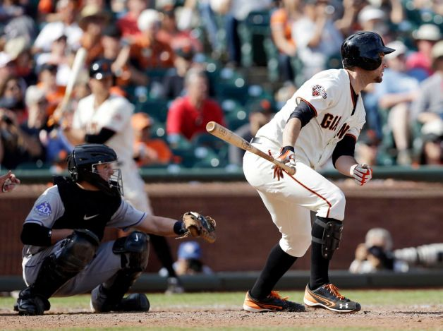 San Francisco Giants' Brandon Belt drives in a run with a single against the Colorado Rockies during the eighth inning of a baseball game on Wednesday, Sept. 11, 2013, in San Francisco. Photo: Marcio Jose Sanchez