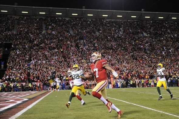 Jan 12, 2013; San Francisco, CA, USA; San Francisco 49ers quarterback Colin Kaepernick (7) scores a touchdown during the first quarter of the NFC divisional round playoff game against the Green Bay Packers at Candlestick Park. Mandatory Credit: Robert Hanashiro-USA TODAY Sports