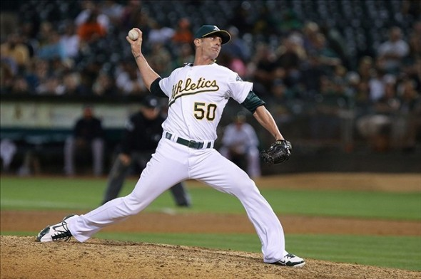 Sep 6, 2013; Oakland, CA, USA; Oakland Athletics relief pitcher Grant Balfour (50) pitches the ball against the Houston Astros during the ninth inning at O.co Coliseum. The Oakland Athletics defeated the Houston Astros 7-5. Mandatory Credit: Kelley L Cox-USA TODAY Sports