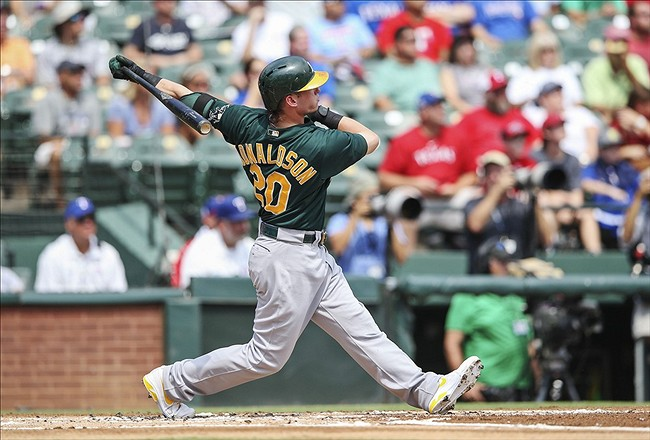 Sep 15, 2013; Arlington, TX, USA; Oakland Athletics third baseman Josh Donaldson (20) hits a home run during the first inning against the Texas Rangers at Rangers Ballpark in Arlington. Mandatory Credit: Kevin Jairaj-USA TODAY Sports
