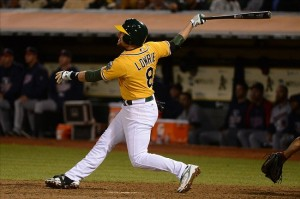 September 19, 2013; Oakland, CA, USA; Oakland Athletics shortstop Jed Lowrie (8) hits a three-run home run against the Minnesota Twins during the sixth inning at O.co Coliseum. Mandatory Credit: Kyle Terada-USA TODAY Sports