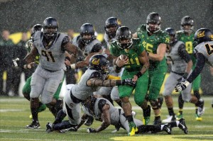 Sep 28, 2013; Eugene, OR, USA; Oregon Ducks running back Thomas Tyner (24) runs the ball in the first half against the California Golden Bears at Autzen Stadium. Mandatory Credit: Scott Olmos-USA TODAY Sports