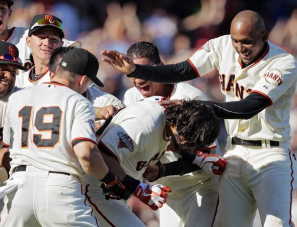 SAN FRANCISCO, CA - SEPTEMBER 8: Angel Pagan #16 of the San Francisco Giants gets swarmed by his team after he hit a walk-off single to score Ehire Adrianza #53 against the Arizona Diamondbacks in the 11th inning at AT&T Park on September 8, 2013 in San Francisco, California. The Giants won 3-2 in 11 innnings. (Photo by Brian Bahr/Getty Images)