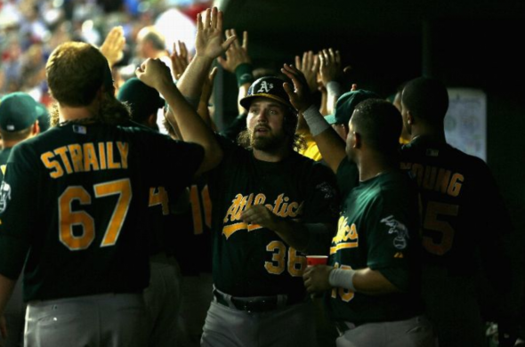 ARLINGTON, TX - SEPTEMBER 13: Derek Norris #36 of the Oakland Athletics celebrates a run against the Texas Rangers at Rangers Ballpark in Arlington on September 13, 2013 in Arlington, Texas. (Photo by Ronald Martinez/Getty Images)