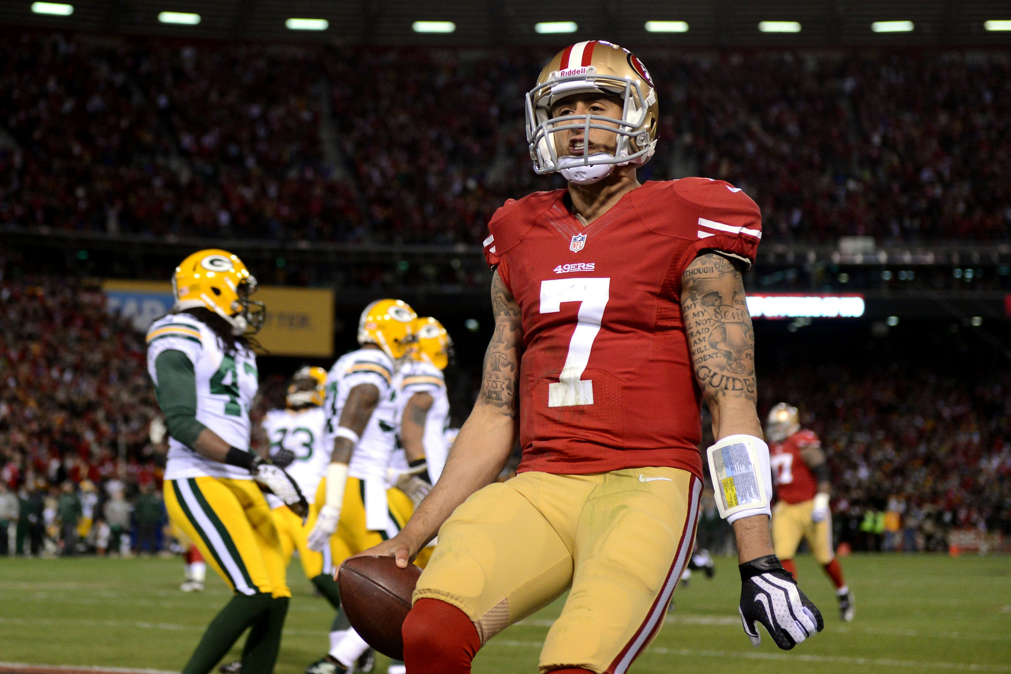 The 49ers' Colin Kaepernick rushed for a quarterback playoff record 181 yards and accounted for 4 touchdowns. Harry How/Getty Images